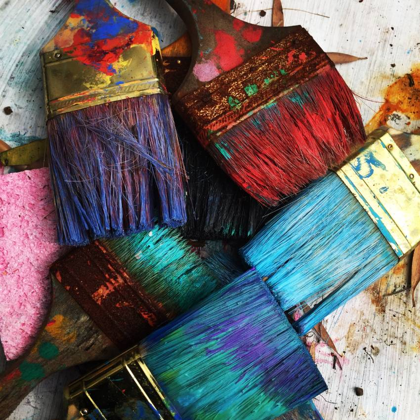 A collection of colourful paint brushes